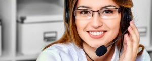 Friendly smiling young woman surrort phone operator at her workp